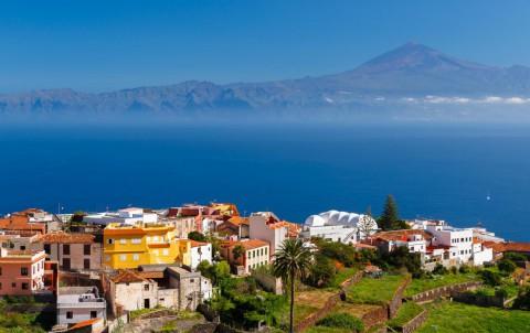 View Agulo town buildings banana plantation Tenerife island Teide volcano background, La Gomera, Canary Islands