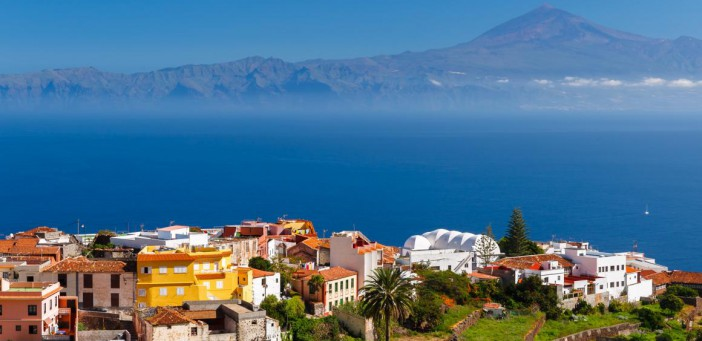 View Agulo town buildings banana plantation Tenerife island Teide volcano background, La Gomera, Canary Islands