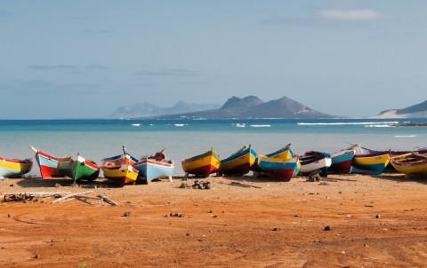 Fishing boats rest in Mindelo beach.
