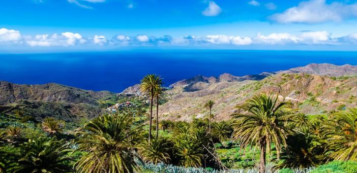 Palm tree valley white clouds blue sky coast sea view mountains, Alojera, La Gomera, Canary Islands
